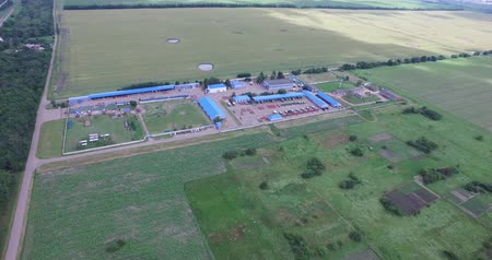 kombajn : the territory of agro-industrial complex of technical buildings, fields planted with different crops
