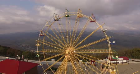 giant wheel : aerial survey Ferris wheel at the top of the mountain