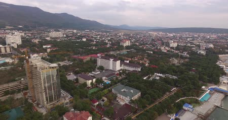 инвестирование : aerial photography of the city in the mountains