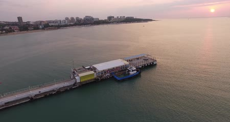 調査 : aerial photography from a quadrocopter, sunset, blue bay, sea jetty