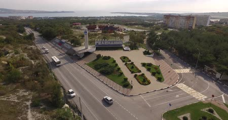 stella : aerial photography of the city, roads drive cars, in the background the sea Stock Footage
