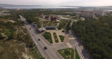 stella : aerial photography of the city, roads are driving cars, hotels on the coast, in the background the black sea Stock Footage