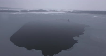 icy : The frozen surface of the lake, birds fly, cold winter