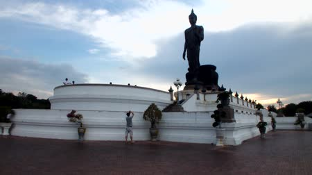 keleti : Tourists around Big Buddha in Thailand