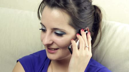 kaukázusi : beautiful young woman talking on the phone