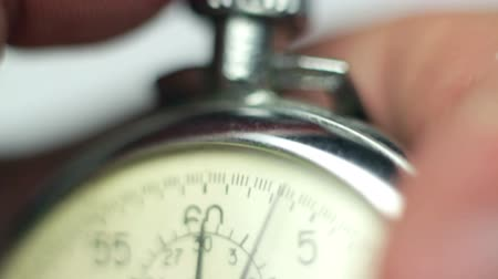 soutěže : man starting and stopping stopwatch close-up