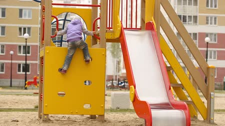 slayt : Little girl playing on the playground Stok Video