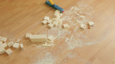 wipe away : Sweeping wooden sawdust off the floor Stock Footage