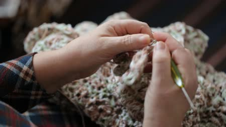 lacy : Woman crocheting lacy dress closeup Stock Footage