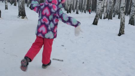 birch forest : Small girl dancing and running in winter forest