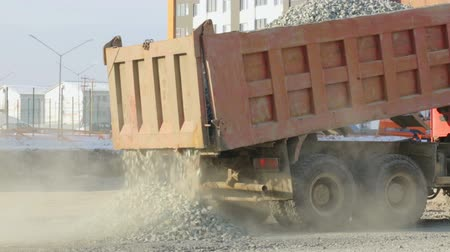 macadam : Lorry-truck unloading at construction site