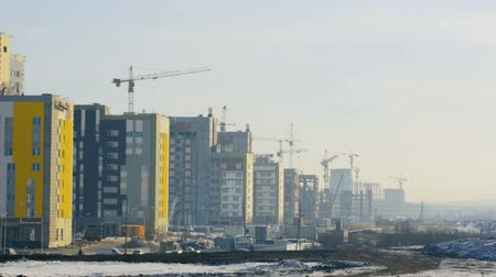 work at height : Buildings under construction at building site Stock Footage