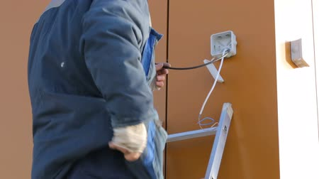 socket : Electrician working at building site Stock Footage