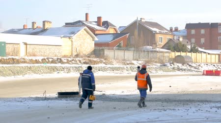 people go to work : Workers walking to the construction site