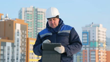 supervising : Foreman with tablet computer at major construction project
