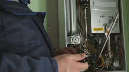 senzor : Worker checking gas-fire boiler