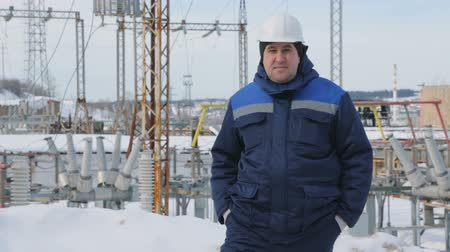 winter day : Engineer at electric power station