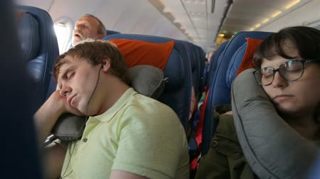 fárasztó : Young couple sleeping in the airplane