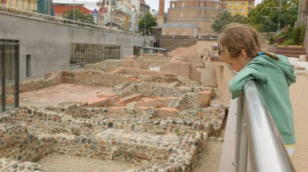 bashi : Little girl at ruins of Serdica in Sofia Stock Footage
