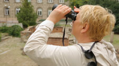 binocular : Woman looking through binoculars