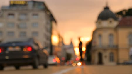 cars traffic : Sunset over the city Stock Footage