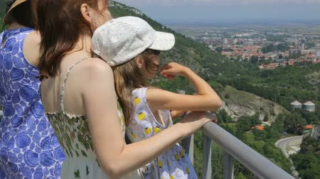 handrails : Tourists on mountain looking down