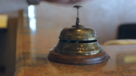 sinos : Woman is ringing reception bell