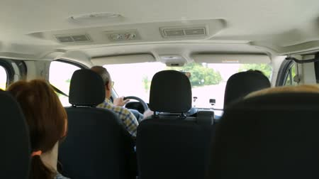 minibus : Group of tourist travelling in car