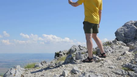 photograph : Young man making selfie on mountain