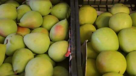 pears : Fruits in boxes in greengrocers shop Stock Footage