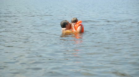 купание : Girl with father in water