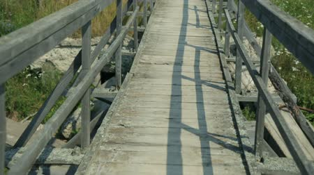 wooden bridge : Walking along a wooden bridge
