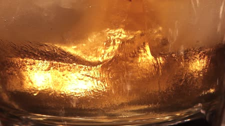 viski : macro video of a glass of whiskey