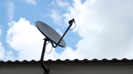 dish : black antenna communication satellite dish over sky, time-lapse