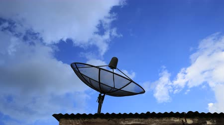 dish : 4k Time-lapse of Satellite dish with blue sky and cloud background