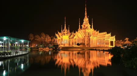 wat pho : Time-lapse of Wat Luang Pho Toh temple with water reflection in twilight time at Nakhon Ratchasima province, Thailand (The public anyone access)