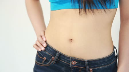 atleta : close up waist of woman in blue jeans Vídeos