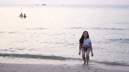 slow motion of woman jumping on the sea beach
