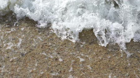 slow motion of wave on the sea beach
