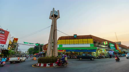 KHONBURI, THAILAND - 24 MARCH, 2018: Day to night timelapse of Khonburi Clock Tower. it is landmark in center downtown of Khonburi district, Nakhon Ratchasima, Thailand