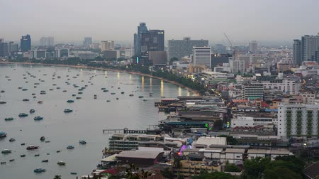 day to night timelapse of Pattaya city and the many boats docking