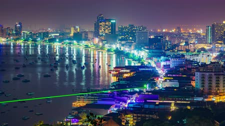 timelapse of Pattaya city and the many boats docking at night