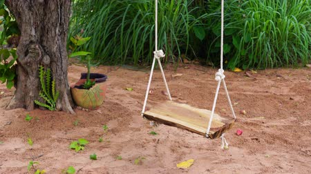 wooden swing in the garden
