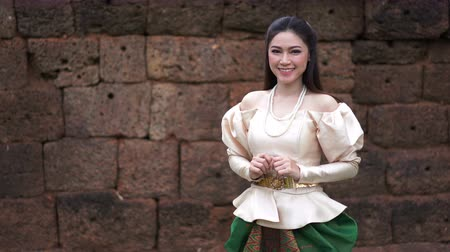 happy beautiful woman in Thai traditional dress