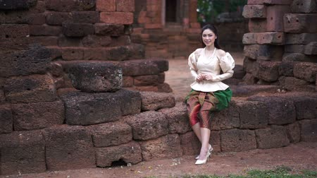 slow motion of happy beautiful woman in Thai traditional dress 影像素材