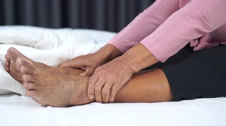 osteoarthritis : close up of senior woman with leg pain in bed