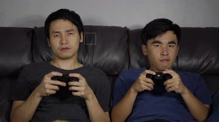konsola : sad two man playing video games and loses