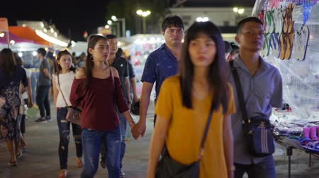 salva vidas : NAKHON RATCHASIMA, THAILAND - 28 SEP 2018 : slow-motion of unidentified people walking and shopping at Save-One market , one of the most popular night market in Nakhon Ratchasima. Tourists like shopping, night market is open every day. Vídeos