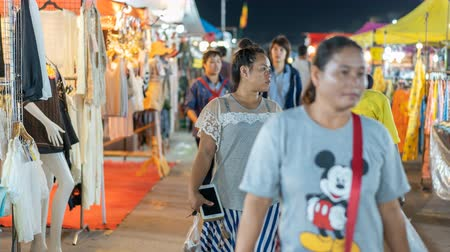 salva vidas : NAKHON RATCHASIMA, THAILAND - 28 SEP 2018 : time lapse of unidentified people walking and shopping at Save-One market, one of the most popular night market in Nakhon Ratchasima. Tourists like shopping, night market is open every day. Vídeos
