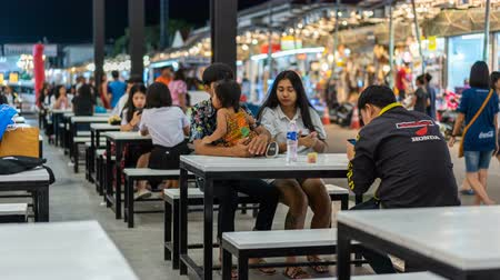 food court : NAKHON RATCHASIMA, THAILAND - 28 SEP 2018 : time lapse of unidentified people eating in food court at Save-One market , one of the most popular night market in Nakhon Ratchasima. Tourists like shopping, night market is open every day. Stock Footage